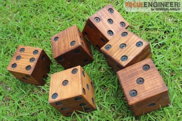 DIY Yard Dice Made Of Wood, Stained, Rolled On Grass