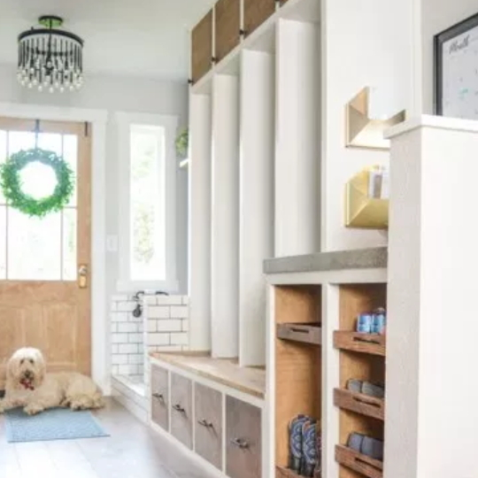 Entryway With White And Wooden Stained Accent Walls And Cubbies