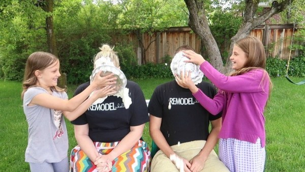 Gender Reveal Photo Two Girls Smashing Pies In Mom And Dad Faces
