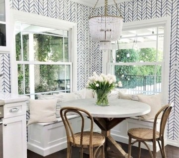 White And Navy Herringbone Wallerpaper With Corner Table And Window To Backyard