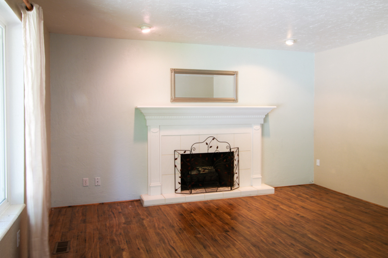 simple fireplace mantel with white tile and white painted mantel