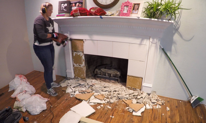 removing tile from a fireplace surround with a hammer drill