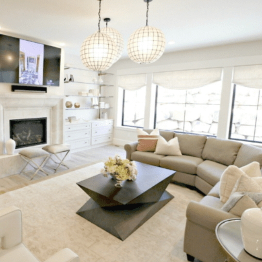 Neutral Transitional Style Living Room With Black Modern Table At Center