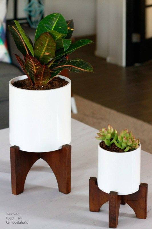 Stained Wood Planters With White Pots And Succulents