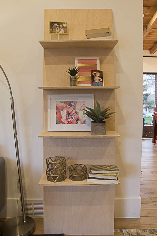 One Sheet Plywood Leaning Shelf With Books, Frames, And Metal Accents