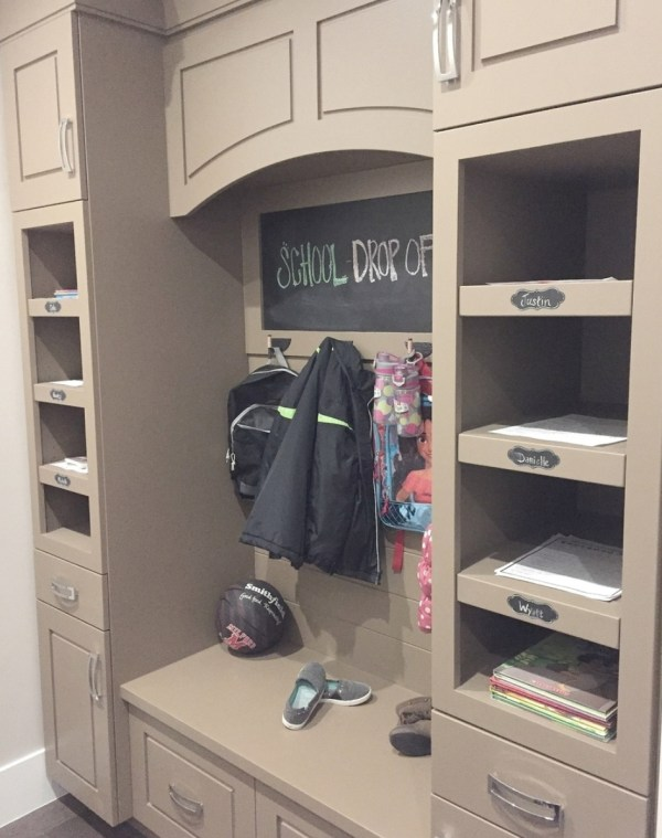 Built In Cubbies With Hooks For Backpacks And Coats, Cupboards And Built In Shelves For Papers And Books And A Bench