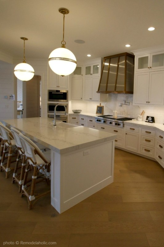 Modern Farmhouse Kitchen Island, Pendant Lighting, White Cabinets, White Backsplash, Copper Range Hood #Remodelaholic