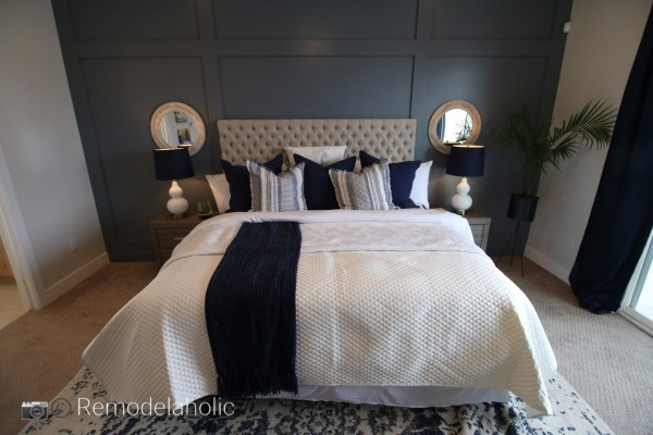 Add some symmetry with a mirror on each side of the bed photo by Remodelaholic