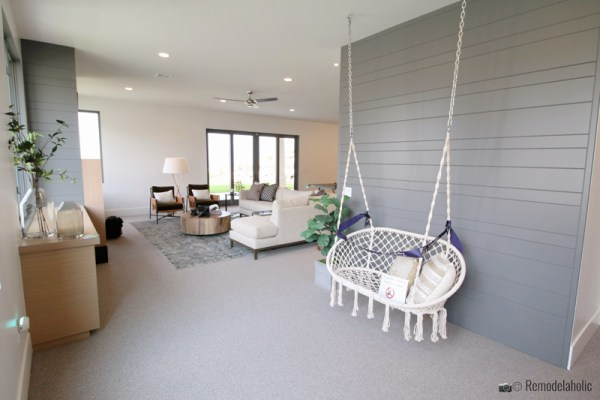 Double hanging chair in a living room area and how to style it, SLPH 2018 Home 14 Magleby Communities (29), photo by Remodelaholic.com