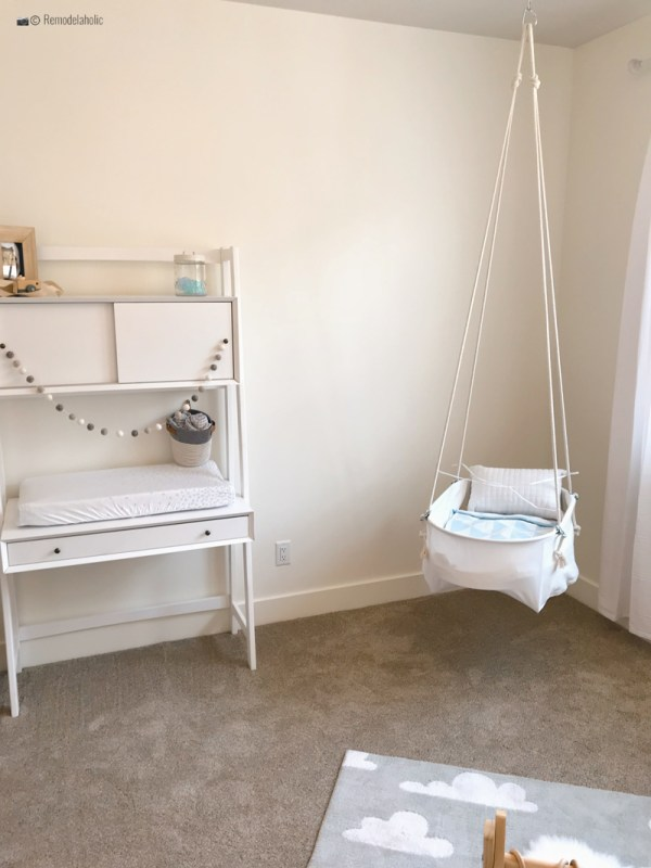 Baby boy nursery with a cute swinging chair hanging from the ceiling. SLPH 2018 Home 5 Regal Homes, photo by Remodelaholic