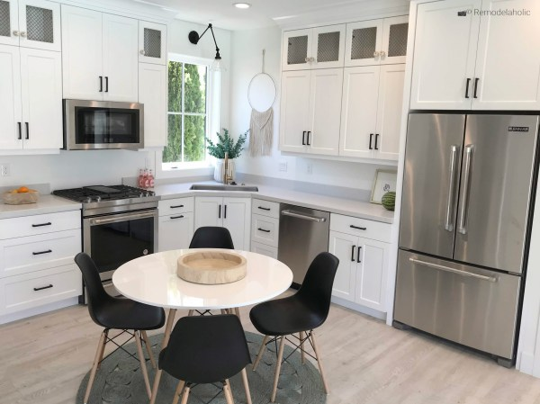 Black modern dining chairs in a white kitchen breakfast nook, UVPH 2018 Home 17 Millhaven Homes, Four Chairs Furniture & Design, photo by Remodelaholic