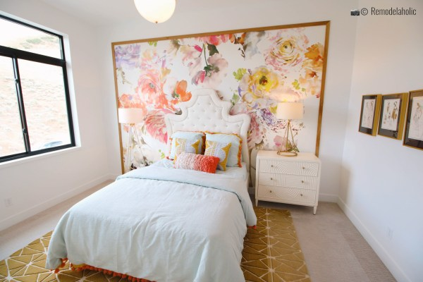 Floral wallpaper statement wall in bedroom with a gorgeous neutral area rug. UVPH 2018 Home 27 Foster Custom Homes, Megan Rae Interiors (220) Photo by Remodelaholic.com