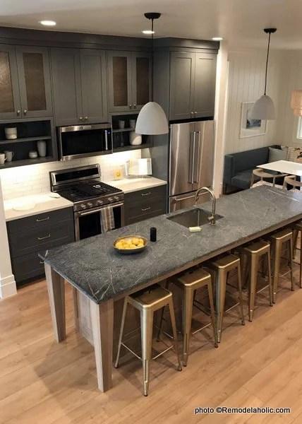 Dark Gray Kitchen Cabinetry, White Countertop, Black Island Counter, UVPH 2018 Home 31 Raykon Construction, White + Gold Design