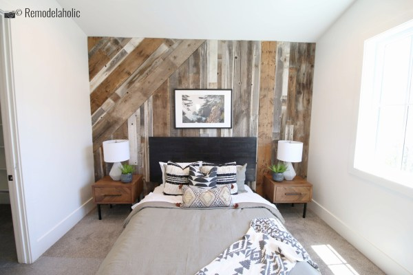 Black modern plank headboard with a rustic wood feature wall, UVPH 2018 Home 17 Millhaven Homes, Four Chairs Furniture & Design, Photo by Remodelaholic