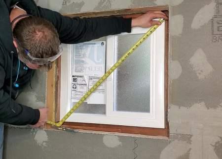 Installing window in basement bathroom