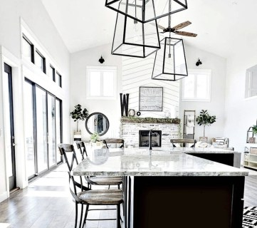 White And Black Kitchen With Wood Paneling Metal And Glass Light Fixtures And Wood Foors
