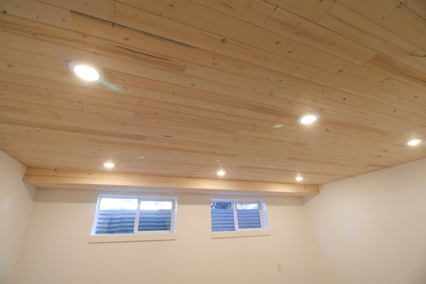 DIY Whitewashed Knotty Pine Wood Plank Ceiling in a Basement