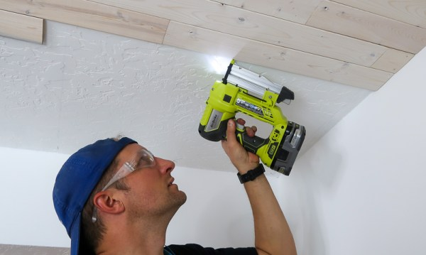 Installing Whitewashed Knotty Pine Boards On Ceiling Nailing With Pin Nailer