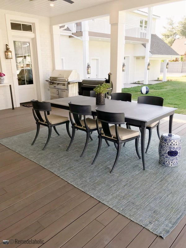 Use an area rug to anchor an outdoor dining space. UVPH 2018 Home 13 Robison Home Builders, Alice Lane Interior Design (405)