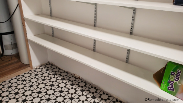 Basement Storage Room With Tile Floor And Track Shelving Storage, Remodelaholic (1)