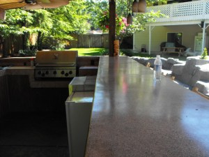 Covered outdoor kitchen with hanging lights