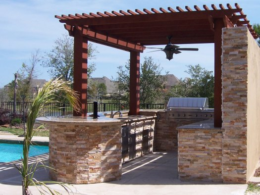 Small outdoor kitchen under pergola