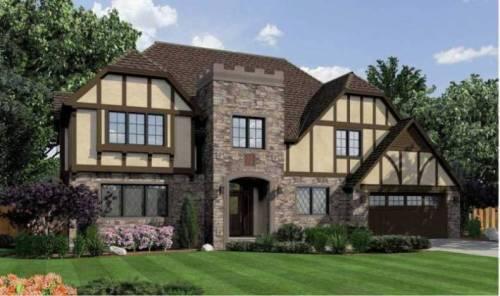 7 Popular Siding Materials To Consider: Stucc And Stone Veneer Siding On A Traditional Tudor House