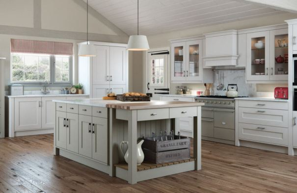Light grey kitchen cabinets in a country style kitchen