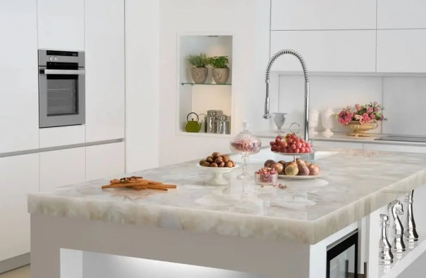Quartz kitchen island countertop in a white kitchen