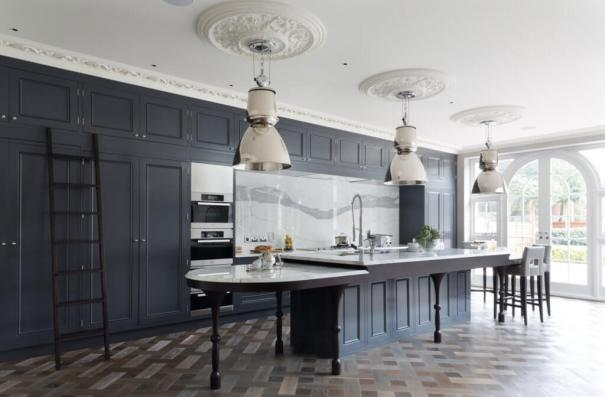 Solid Slab Marble Backsplash in a black kitchen