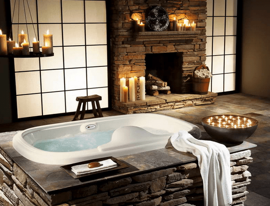bathtub-surrounded-by-natural-stones-and-design-candles