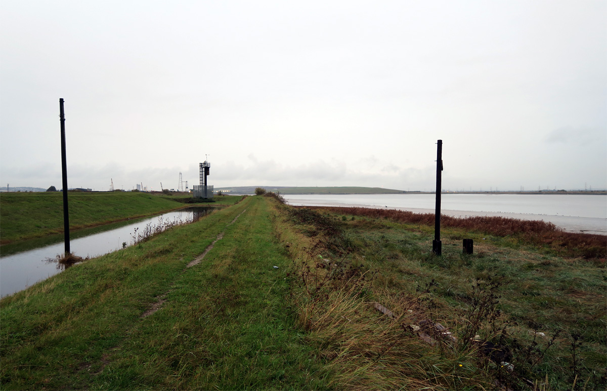 Mile posts facing the River Thames on Dartford Marshes mark location of lost Long Reach Tavern