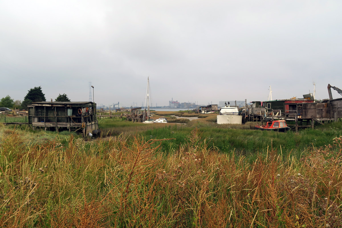 Old boats and shacks in a shallow creek on Swanscombe Peninsula