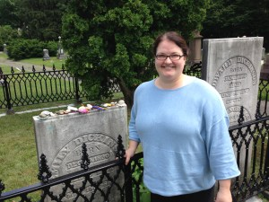 Courtney at Emily Dickinson's grave Buried with her family, as she lived her life Remembered by many, including us, leaving stones, pennies, shells, pencils, notes, and even a book