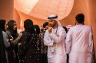 A group of young female visitors escorted by their young male relatives in the Expo United Arab Emirates pavilion during UAE National Day. Nikon D810, 120mm (24-120 ƒ/4) 1/400 sec ƒ/4 ISO 400