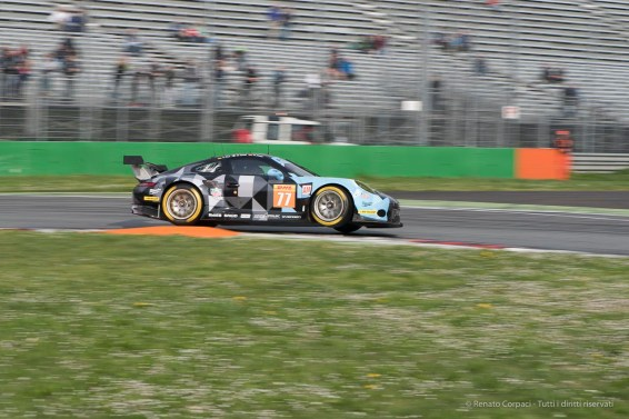 """Porsche 911 RSR (991) takes off on the kerb at the First Chicane. Nikon D810, 105 mm (105.0 mm ƒ/2.8) 1/100"""" ƒ/10 ISO 64"""