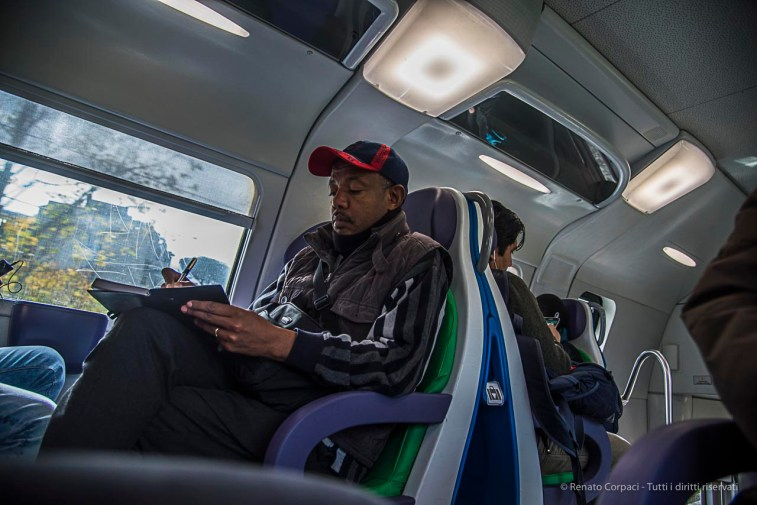A person taking detailed notes on the train from Bracciano to Rome. Nikon D810, 27 mm (24-120.0 mm ƒ/4) 1/160 ƒ/4 ISO 250