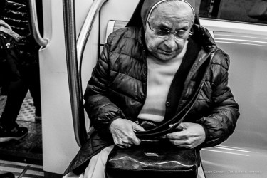 A nun on the subway Line A. Nikon D810, 35 mm (35.0 mm ƒ/2) 1/160 ƒ/8 ISO 12800