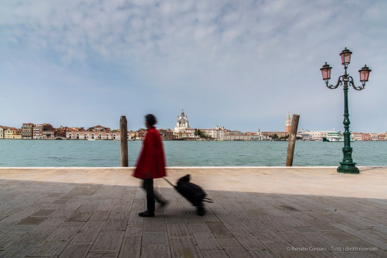 A resident carrying a trolley with groceries in Venezia, Giudecca island, with the Basilica della Salute in the background. Nikon D810, 24 mm (24.0-120.0 mm ƒ/4) 1/25 ƒ/22 ISO 64.
