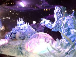 The sixth holiday window of the story, Uranus and Neptune, the Ice Giants, celebrate with a snowball fight to end snowball fights