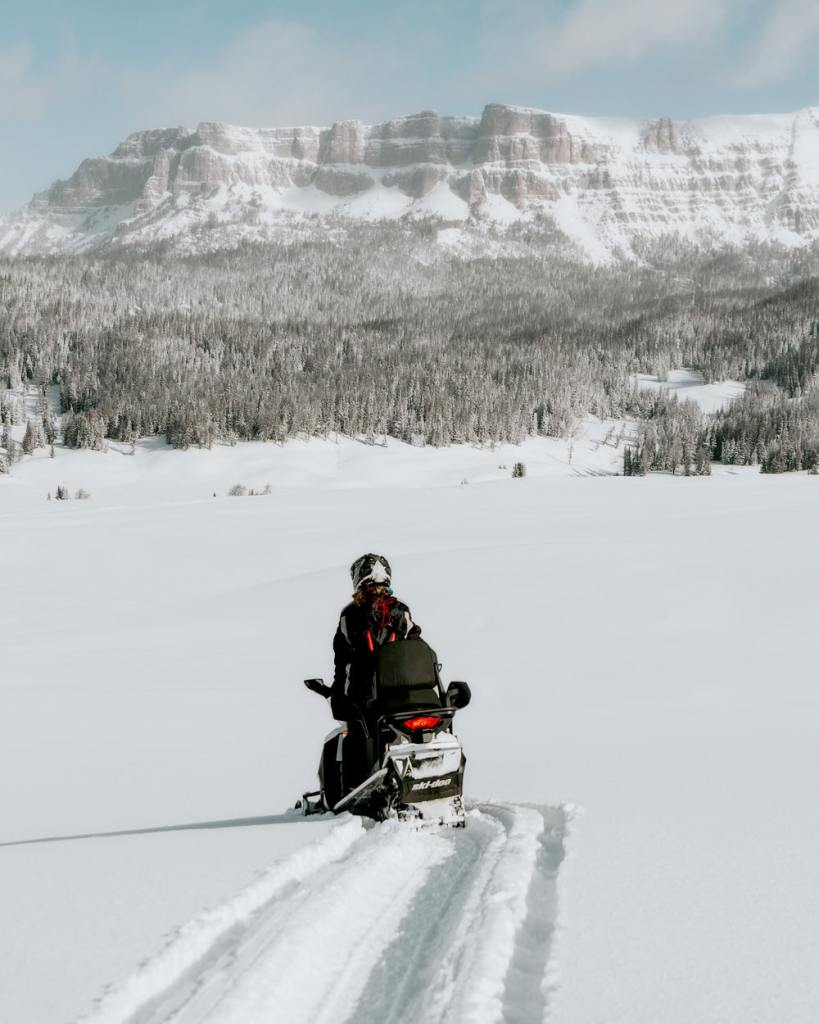 12 Best National Parks to Visit in Winter - Grand Teton National Park Snowmobiling