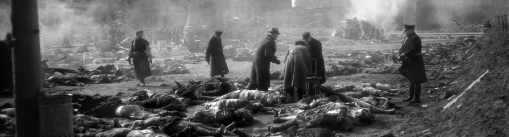 Photo dated 25 February 1945 showing residents and emergency personnel lining up bodies to be burned at the Old Market in the east German city of Dresden, following allied bombings 13 February 1945. The 60th anniversary of the massive fire bombing of the city, which killed anywhere between 25,000 to 135,000 people, many of them refugees fleeing the Russian advance, will be commemorated in Dresden 13 February 2005, amidst calls by far-right parties to hold a mass rally in Dresden on the occasion. AFP PHOTO SLUB DEUTSCHE FOTOTHEK/WALTER HAHN (Photo credit should read WALTER HAHN/AFP/Getty Images) BRL103