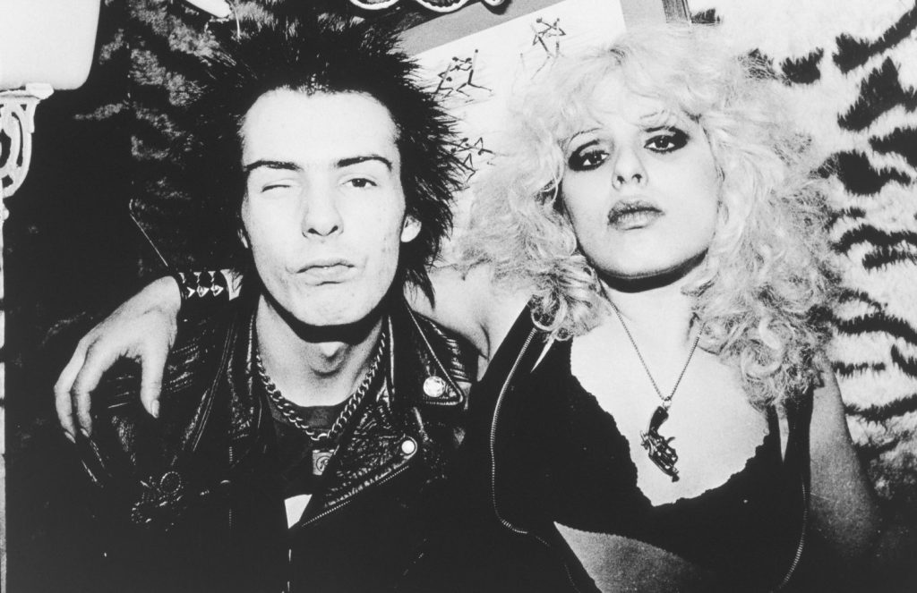 Sid Vicious & Nancy (Laura) Spungen (a.k.a. 'Nauseating Nancy' by the press) in London 1978. Not that this character was anywhere relevant to the Punk movement save for the fact that she was Sid Vicious' Jewish girlfriend, who also happened to be a schizophrenic with an insatiable appetite for hard drugs, described in the documentary 'The Filth & The Fury' (2000) by Sex Pistols' guitarist Steve Jones as a 'very strange bird with a dark cloud hovering above her' (slightly misquoting the statement). The Spungens were a middle-class Jewish family from Philadelphia. Young Nancy was a difficult baby, 'throwing crying fits and temper tantrums late into childhood'. The cause of her death has been a subject of endless speculation in the music press. The official narrative is that she was stabbed in the abdomen by her boyfriend (though that is very debatable). The case echoes Kurt Kobain's story in the sense that he also had a Jewish girlfriend, Courtney Love, who in this case could have been the killer herself instead of the victim (though that is also material for speculation and 'conspiracy theory'). Funny it was precisely Courtney Love who auditioned to play the role of Nancy Spungen in the Samuel Goldwyn Company's biopic 'Sid and Nancy' (1986) though the role was finally given to actress Chloe Webb (Courtney Love was finally given the role of 'Gretchen' in the same movie). It would have been a huge 'cohencidence' had Love gotten the role herself, but that is another story. As a piece of trivia, Courtney Love was the stepdaughter of once Grateful Dead's publisher and road manager Hank Harrison.