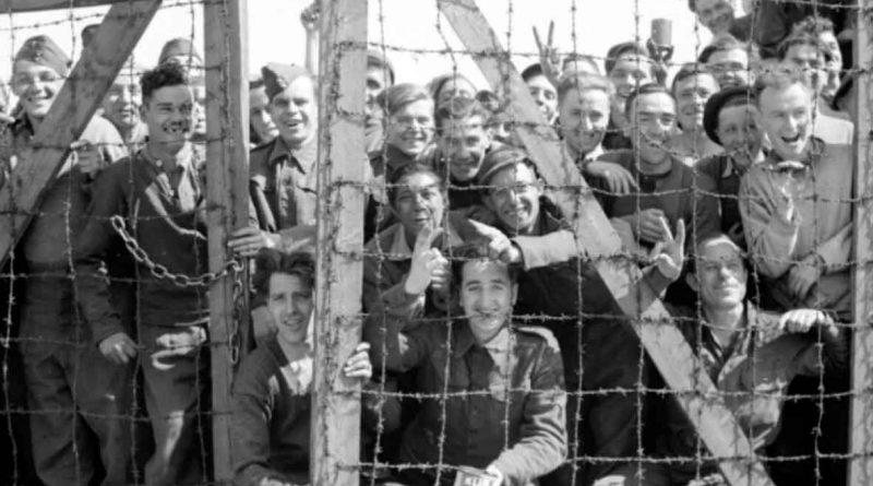 POWs at Stalag 11B at Fallingbostel in Germany welcome their liberators, 16 April 1945.  BU 3661 Part of WAR OFFICE SECOND WORLD WAR OFFICIAL COLLECTION  No 5 Army Film & Photographic Unit Smith (Sgt)