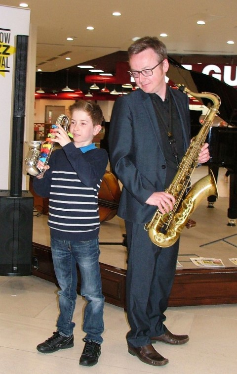 All that jazz – nine-year-old Andrew Colville was visiting intu Braehead when he joined in a performance with sax player, Brian Molley.