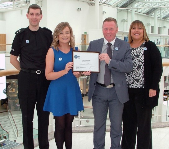 General manager of intu Braehead, Gary Turnbull receives the Keep Safe training certificate from Megan Milligan, I Am Me Project intern with Police Scotland Inspector Steven Espie, left and intu Braehead customer services manager, Christine Olsen.