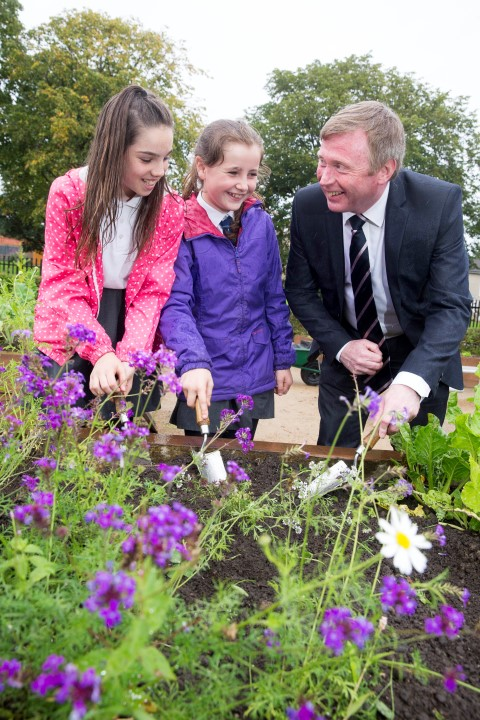 Digging deep - from left Todholm Primary pupils, Mirin Gray and Zara Neil with intu Braehead general manager, Gary Turnbull