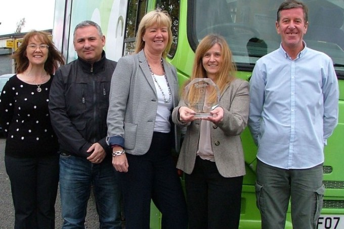 From left, Joyce Higgins, digital and libraries development manager; Jimi McGuigan, children and families mobile worker; Joyce McKellar, Renfrewshire Leisure chief executive; Pauline Simpson, mobile library co-ordinator with the award and Laurence Doherty, children and families mobile worker