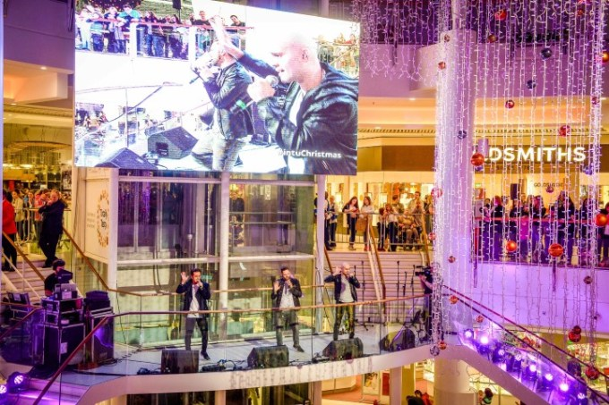 Boy band 5ive go through their hits for the fans at intu Braehead as their performance was shown in the giant screen above the central atrium.