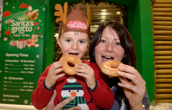 Five-year-old Jack Stevenson and his mum, Isla, from Glenburn, in Paisley were first in the queue for a free box of Krispy Kreme doughnuts.